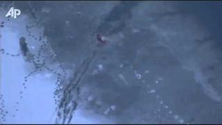 Raw Video: Dog Rescued From Icy Colo. Water