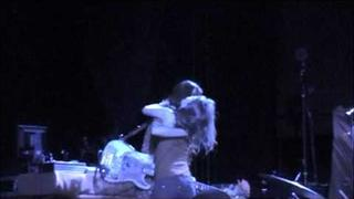 A crazy girlie attempts a make out session with Paz Lenchantin in Detroit.