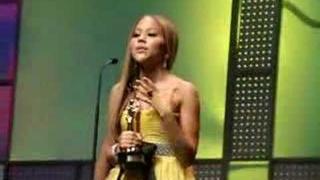 Kat accepting her Cassandra Award