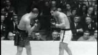 knocks out Joe Louis