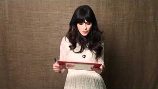 Zooey Deschanel Help's Haiti Home